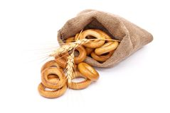 Burlap sack with bagels and ears Royalty Free Stock Photography