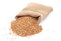 Burlap sack with buckwheat spilling Stock Photo
