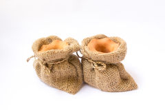 Burlap sack clay pots Royalty Free Stock Image