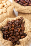 Burlap sack with coffee royalty free stock images
