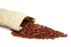Burlap Sack & Coffee Beans. Burlap Sack with Coffee Beans spilling out - isolated Stock Image