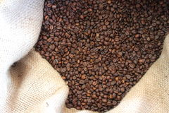 Burlap sack and coffee beans. Burlap sack over a coffee beans background Stock Photo