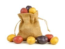Burlap sack of colorful little potatoes over white Royalty Free Stock Photo