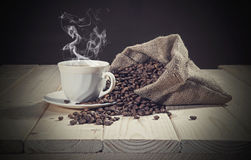 Burlap sack full of coffee beans Stock Photo