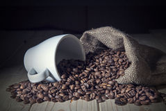 Burlap sack full of coffee beans Stock Photography