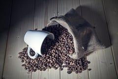 Burlap sack full of coffee beans Stock Photo