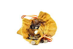 Burlap sack full of coins  and stack of coins  come out from sac. K on white background.3 Royalty Free Stock Image