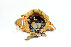 Burlap sack full of coins  and stack of coins  come out from sac. K on white background.1 Stock Photography