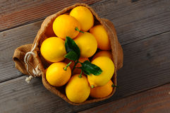 Burlap Sack Full of Lemons Royalty Free Stock Photos