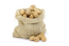 Burlap sack full of whole walnuts Stock Photos