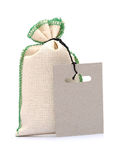 Burlap sack with a label stock images