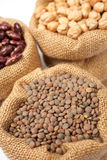 Burlap sack with lentils Stock Photography