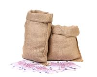Burlap sack with money. Stock Image
