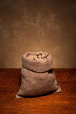 Burlap sack of peanuts Royalty Free Stock Photography
