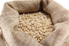 Burlap sack with pearl barley Royalty Free Stock Photos