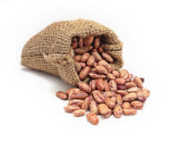 Burlap sack with red beans spilling out Royalty Free Stock Photo