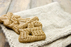Burlap sack with two Dutch cookies called speculaasjes Stock Photo