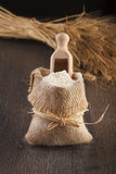 Burlap sack with white flour Royalty Free Stock Photography