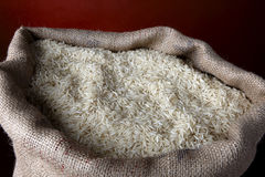 Burlap sack of white rice Royalty Free Stock Photography