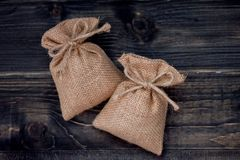 Burlap sack on wooden table royalty free stock images