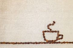 Burlap Sackcloth Canvas and Coffee Beans Photo Background. Copy Royalty Free Stock Photo