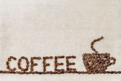 Burlap Sackcloth Canvas and Coffee Beans Photo Background. Copy Royalty Free Stock Photos