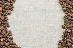 Burlap Sackcloth Canvas and Coffee Beans Placed Round Photo Back. Ground. Copy Space. Coffee Border stock images