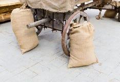 Burlap sacks near cart stock photos