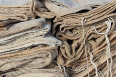 Burlap sacks. A pile of wheat colored burlap sacks with string ties Royalty Free Stock Photography