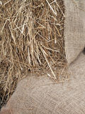Burlap with Straw. A bale of loose straw with a burlap accent Royalty Free Stock Photos