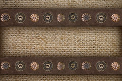 Burlap with suede edging and buttons Stock Image