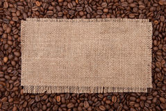 Burlap tag. On the background of coffee Royalty Free Stock Images