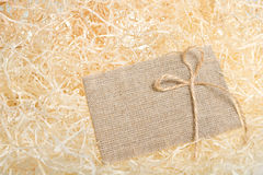 Burlap tag on straw background. Sack cloth Royalty Free Stock Image
