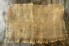 Burlap textil background on wood table Stock Photo