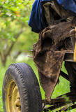 Burlap textile over machine with tire in village. Burlap textile over machine with tire in village Stock Photography