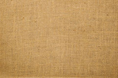 Burlap texture. Textured background of beige fabric royalty free stock image