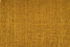 Burlap texture of artificial fibers Royalty Free Stock Images