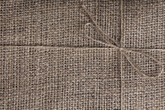Burlap texture background of wool threads which tied bow Royalty Free Stock Images