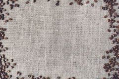 Burlap texture with coffee beans border Royalty Free Stock Photography
