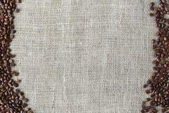 Burlap texture with coffee beans border Stock Photo