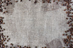 Burlap texture with coffee beans border Stock Image