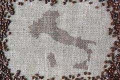 Burlap texture with coffee beans border Royalty Free Stock Photos