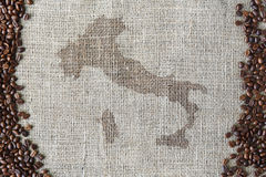 Burlap texture with coffee beans border Royalty Free Stock Photo