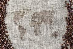 Burlap texture with coffee beans border and world map Stock Photography