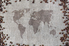 Burlap texture with coffee beans border and world map Royalty Free Stock Photography