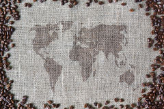 Burlap texture with coffee beans border and world map Stock Images