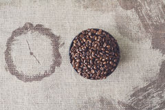 Burlap texture and coffee beans bowl with clock shape Stock Photography