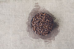 Burlap texture with coffee beans heart shape Stock Images