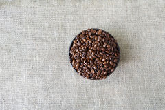 Burlap texture with coffee beans heart shape Stock Photography
