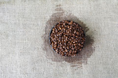 Burlap texture with coffee beans heart shape Royalty Free Stock Photography